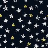 Seamless pattern with doodled stars Stock Image