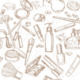 Seamless pattern from doodles of cosmetic cream, lipstick, powde Royalty Free Stock Images