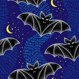 Seamless pattern with dotted bats in black. Halloween background with traditional symbol. Stock Photos