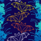 Seamless pattern with dotted bats and colorful blots. Halloween background with traditional symbol Stock Photos