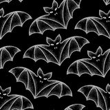 Seamless pattern with dotted bats in white. Halloween background with traditional symbol. Royalty Free Stock Photo