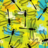Seamless pattern with dotted black dragonflies on the colorful blots background Stock Image