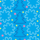 Seamless pattern with dotted Christmas trees in blue and snowflakes. Royalty Free Stock Images