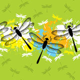 Seamless pattern with dotted dragonflies in black and colorful blots Royalty Free Stock Photography