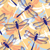 Seamless pattern with dotted dragonflies in blue Stock Photos