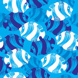 Seamless pattern with dotted fish in white and in blue Royalty Free Stock Photo