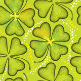 Seamless pattern with dotted four leaf clover on the green background with blots. Traditional symbol of St. Patrick Day. Royalty Free Stock Photography