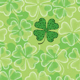 Seamless pattern with dotted four leaf clover in white on the green background. Traditional symbol of St. Patrick Day. Stock Photography