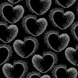 Seamless pattern with dotted hearts on a black background Royalty Free Stock Image