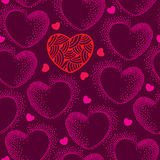 Seamless pattern with dotted hearts on a dark background Stock Image