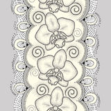 Seamless pattern with dotted moth Orchid or Phalaenopsis, swirls and decorative lace on the light yellow background. Royalty Free Stock Photo