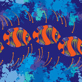 Seamless pattern with dotted orange fish and blue blots Royalty Free Stock Images