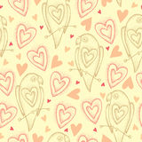 Seamless pattern with dotted parrots in pastel beige and hearts Stock Image
