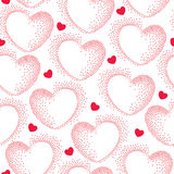 Seamless pattern with dotted pink hearts Stock Image