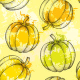 Seamless pattern with dotted pumpkin and colorful blots on the yellow background Royalty Free Stock Photography
