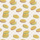 Seamless pattern of double cookies with a layer of cream, sweets or pastilles. Stock Images