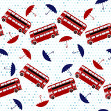 Seamless pattern with double-decker buses and umbrellas under th Stock Image