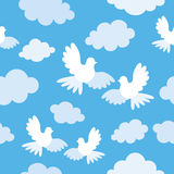 Seamless pattern with doves and clouds Stock Image