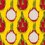 Seamless Pattern with Dragon Fruit or Pitaya. Whole and Cross Section on a Yellow Background Royalty Free Stock Photo