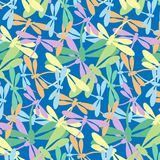 Seamless pattern with dragonflies pastel color on blue background. Perfect for textiles and wrapping paper Stock Image