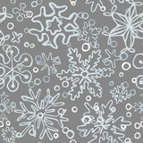 Seamless pattern of drawn by hand snowflakes Stock Photography