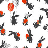 Seamless  pattern with Easter bunnies. Festive background. Easter background with rabbits and eggs Royalty Free Stock Images