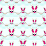 Seamless pattern with Easter bunny ove light blue Stock Image