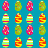 Seamless pattern with easter eggs. On the blue background Stock Images