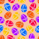 A seamless pattern, Easter eggs with a bow. Stock Images