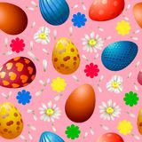 Seamless pattern with Easter eggs and chamomiles on a pink background vector illustration