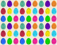 Seamless pattern with Easter eggs with smiling faces Stock Image