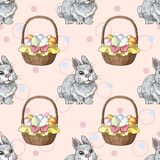 Seamless pattern with easter rabbits and baskets with eggs. Greate holiday background Royalty Free Stock Photos