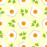 Seamless pattern with eggs and sprigs of parsley Royalty Free Stock Photos