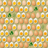 Seamless pattern with eggs,  yolks  and parsley leaves. Royalty Free Stock Images