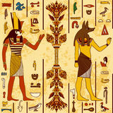 Seamless pattern with egyptian gods and ancient egyptian hieroglyphs on grunge aged paper background. Stock Photo