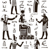Seamless pattern with egyptian gods and ancient egyptian hieroglyphs. Stock Photo