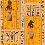 Seamless pattern with egyptian gods and ancient egyptian hieroglyphs. Royalty Free Stock Images
