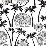 Seamless pattern with elephants and palms. Stock Images
