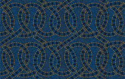 Vector seamless pattern embroidered on blue denim texture background Royalty Free Stock Images