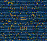Vector seamless pattern embroidered on blue denim texture background Royalty Free Stock Photo