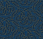 Vector seamless pattern embroidered on blue denim texture background Stock Photos