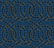 Vector seamless pattern embroidered on blue denim texture background Stock Photography