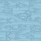 Seamless pattern in ethnic style with fish on blue background Royalty Free Stock Image