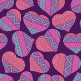 Seamless pattern with ethnic style hearts Royalty Free Stock Photo