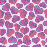 Seamless pattern with ethnic style hearts Stock Image