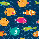 Seamless pattern with exotic fish on the waves Royalty Free Stock Image