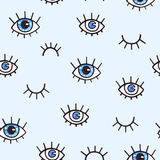 Seamless pattern with eyes on a blue background. Bohemian style background for design. Abstract print of open and close eyes. Hand Royalty Free Stock Image