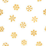 Seamless pattern of falling golden snowflakes. On white background. Elegant pattern for Christmas or New year background, festive banner, card, invitation Stock Images