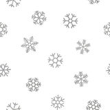 Seamless pattern of falling silver snowflakes. On white background. Elegant pattern for Christmas or New year background, festive banner, card, invitation Royalty Free Stock Image