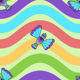 Seamless pattern of fantastic bluebird on rainbow wavy background Stock Photo